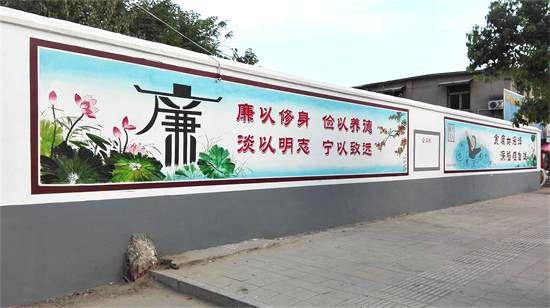 在凤阳县城的大街小巷墙面上,一幅幅图文并茂的廉政宣传画跃然墙面